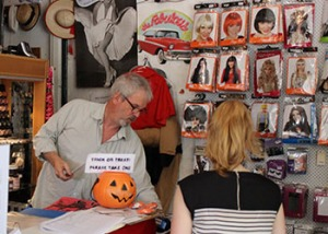 Nigel Devenport serves a customer on Halloween