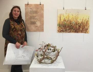 Janeen Cameron in front of her artwork